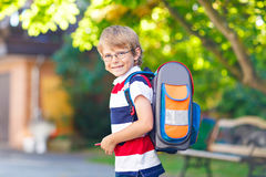 Little kid boy with school satchel on first day to school Royalty Free Stock Images