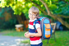 Little kid boy with school satchel on first day to school Stock Images