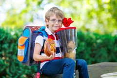 Little kid boy with school satchel on first day to school Royalty Free Stock Photo