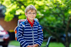 Little kid boy with school satchel on first day to school Royalty Free Stock Photography
