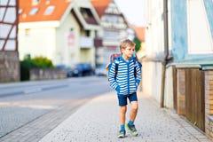 Little kid boy with school satchel on way to school Stock Images
