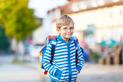 Little kid boy with school satchel on way to school Stock Photography