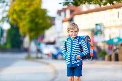 Little kid boy with school satchel on way to school Royalty Free Stock Photos