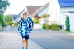 Little kid boy with school satchel on way to school Stock Photography