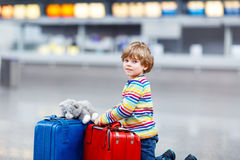 Little kid boy with suitcases on international airport Royalty Free Stock Image