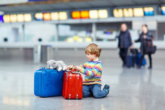Little kid boy with suitcases on international airport Stock Photography