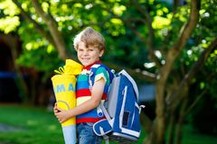 Free Little Kid Boy With School Satchel On First Day To School, Holding School Cone With Gifts Royalty Free Stock Photos - 121423808