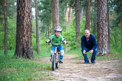Little kid boy of 3 years and his father in autumn forest with a Royalty Free Stock Images