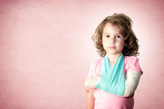 Little kid with broken hand Royalty Free Stock Photos