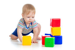 Little kid with building blocks. Little boy with building blocks royalty free stock photos