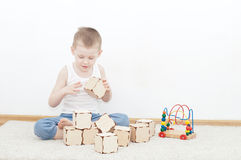 Little kid is building tower Stock Photos