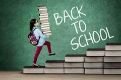 Little kid carrying books Stock Photography