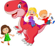 Little kid cartoon playing on the dinosaur Stock Images