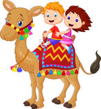 Little kid cartoon riding decorated camel. Illustration of Little kid cartoon riding decorated camel Stock Images
