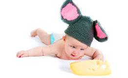 The little kid  with cheese Royalty Free Stock Photos
