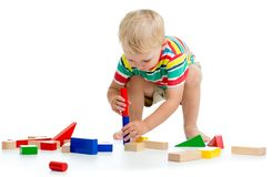 Little kid boy playing with toys isolated on white background royalty free stock images