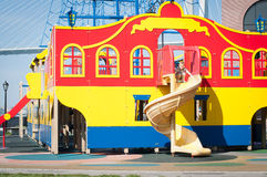 Little kid on children's slide Royalty Free Stock Images
