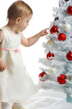 Little kid with a christmas tree Stock Image