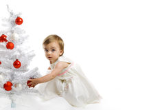 Little kid with a christmas tree stock photos