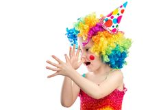 Little kid clown shows something funny. Cute little kid clown shows something entertaining with her hands in front her nose isolated on white background royalty free stock photos