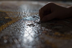 Little kid completed the puzzle . Last pieces inserting moment. Royalty Free Stock Photos