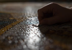 Little kid completed the puzzle . Last pieces inserting moment. Royalty Free Stock Images