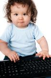 Little kid with a computer keyboard Stock Photo