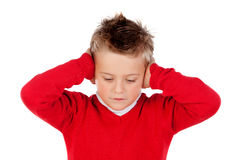 Little kid covering the ears Stock Image