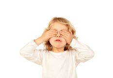 Little kid covering his eyes Stock Images