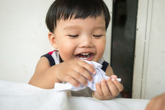Creativity boy creating something different and laughing. Little kid creating something different and laughing Stock Photos