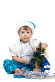 Little kid decorating Christmas tree Royalty Free Stock Image