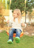 Little kid - disheveled girl on swing Stock Photography