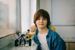 Little kid with diy robot at stem. Education class royalty free stock photos