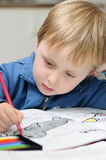 Little kid drawing Royalty Free Stock Photos