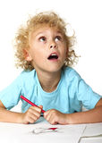 Little kid drawing and thinking Stock Image