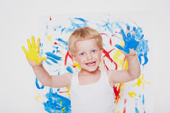 Little kid draws bright colors. School. Preschool. Education. Creativity. Studio portrait over white background royalty free stock photos