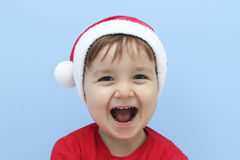 Little kid dressed as santa claus laughing Royalty Free Stock Photos