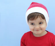 Little kid dressed as santa claus smiling Stock Image