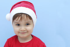Little kid dressed as santa claus smiling Royalty Free Stock Photo