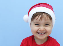 Little kid dressed as santa claus smiling Royalty Free Stock Images