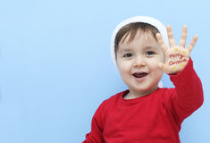 Little kid dressed as santa claus smiling Stock Photos