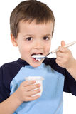 Little kid eating yoghurt Royalty Free Stock Photo