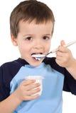 Little kid eating yoghurt Royalty Free Stock Photo
