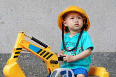 Little kid on the excavator toy Royalty Free Stock Photo