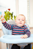 Little kid in feeding chair Royalty Free Stock Image