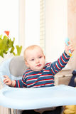 Little kid in feeding chair Stock Photography