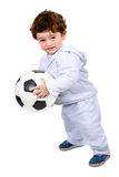 Little kid with a football Royalty Free Stock Image
