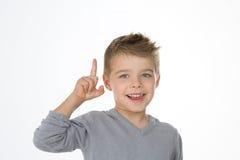 Little kid found the right idea Stock Image