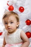 Little kid in front of a christmas tree Stock Photos