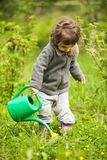 Little kid in the garden Stock Images